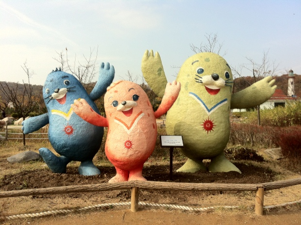 Mascots of the Incheon Games - spotted seals named Vichuon, Chumuro and Barame - at the Incheon Grand Park